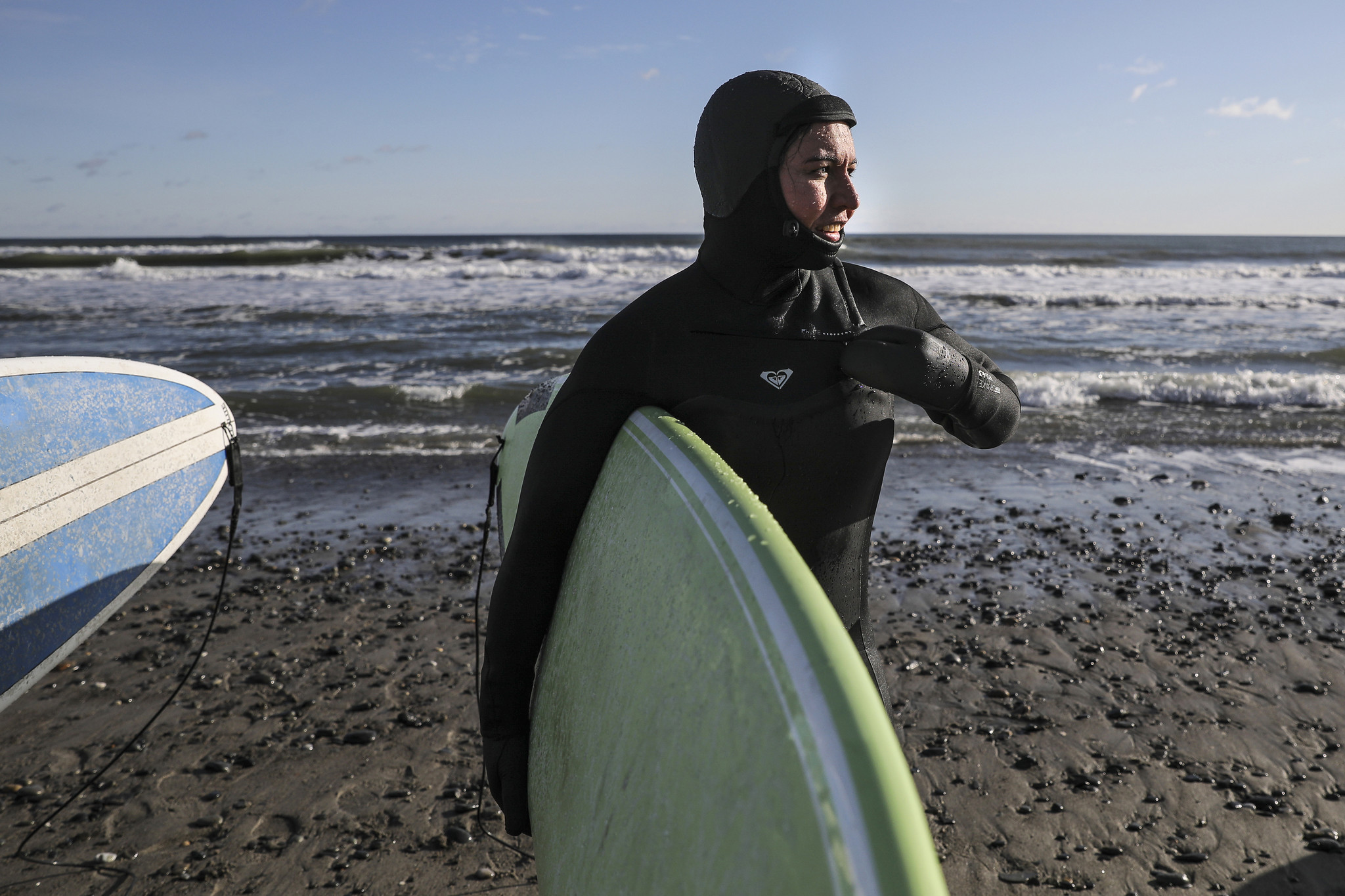 Tulsi Gabbard goes surfing in chilly New Hampshire