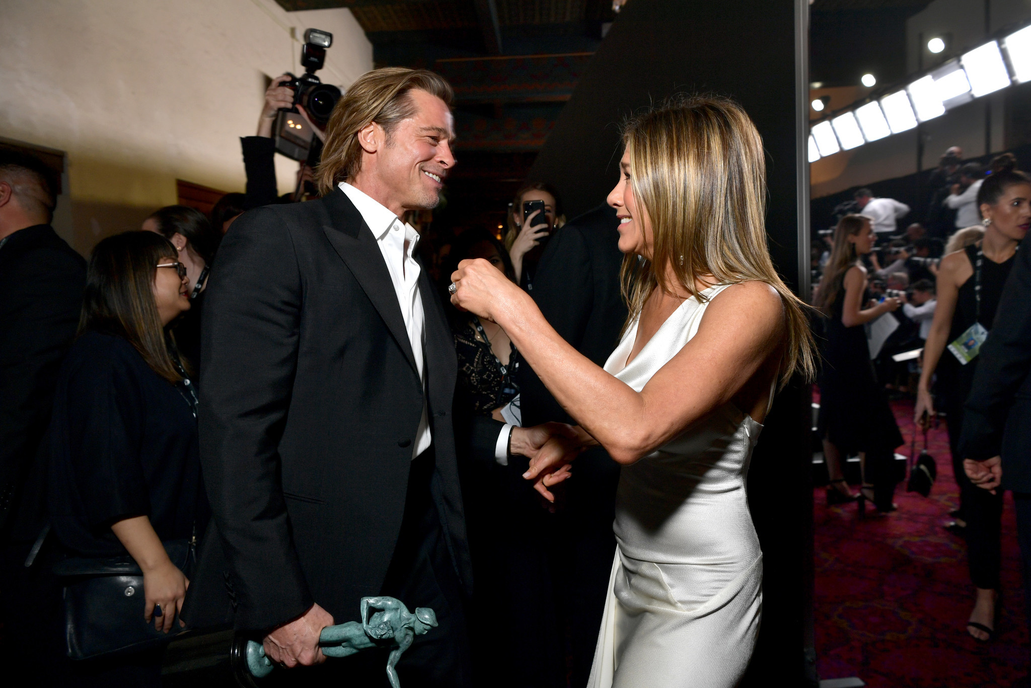 Brad Pitt and Jennifer Aniston reunite after SAG award wins — and everyone swoons