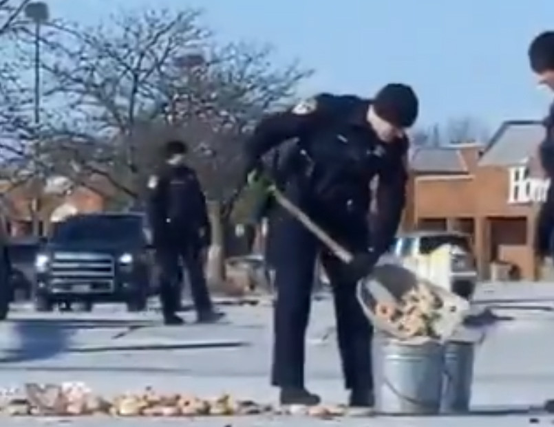 Cops shovel doughnuts, but not into their mouths