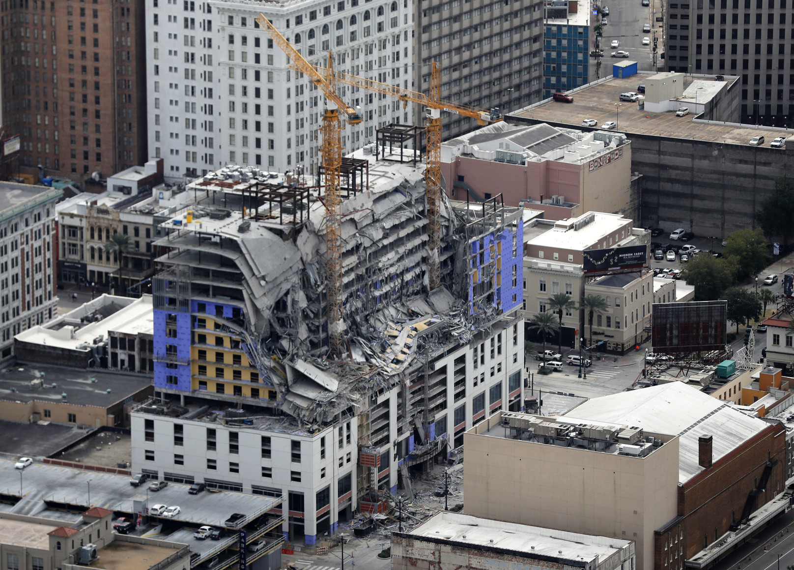 Body of worker who died in New Orleans hotel collapse exposed after tarp blows away