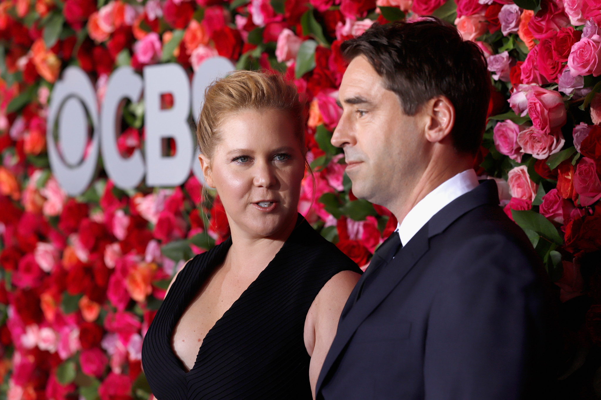 Amy Schumer's ex, Kyle Dunnigan, has been living with her and husband Chris Fischer since late last year