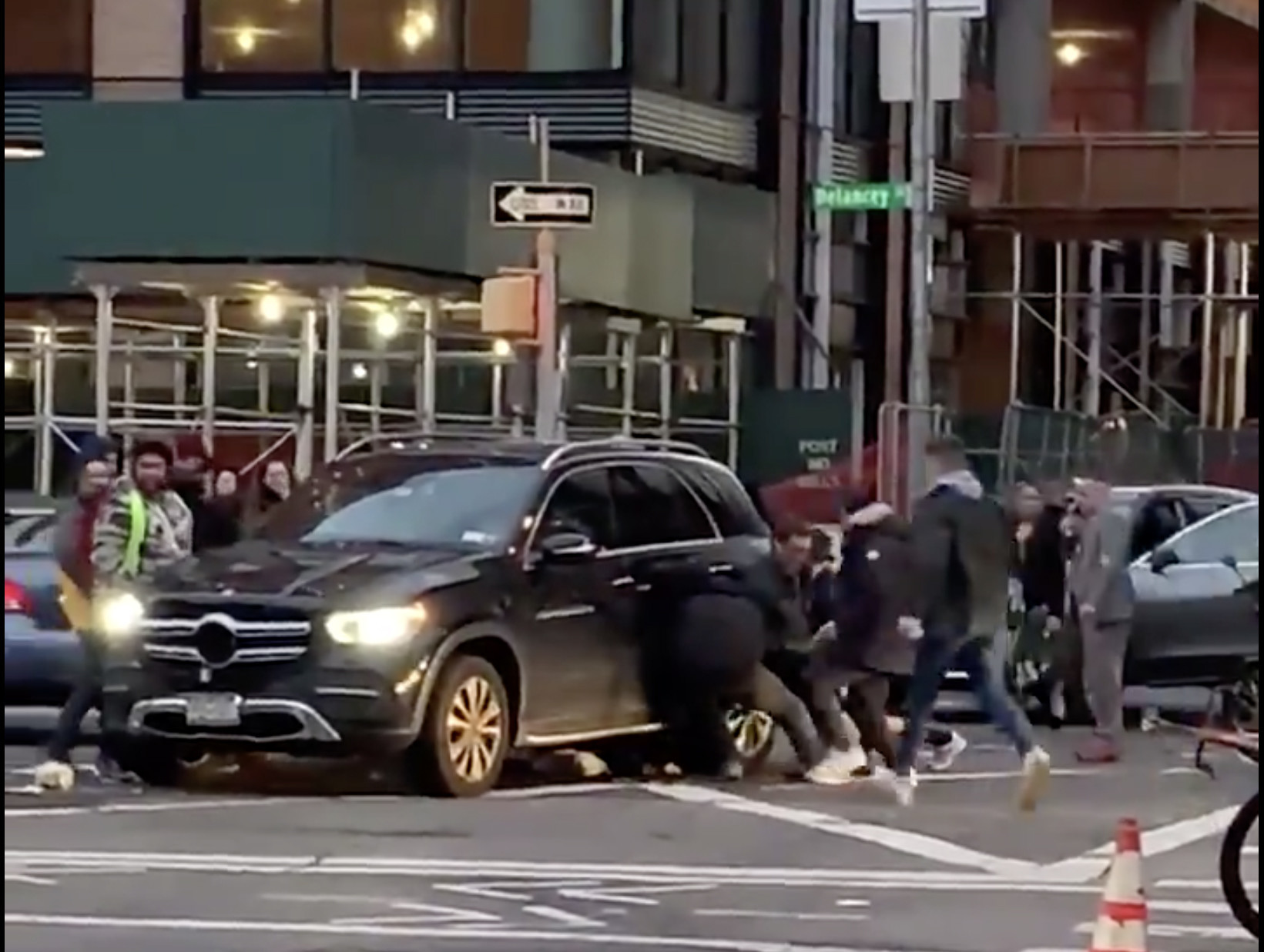 SEE IT: Manhattan bystanders lift SUV to free woman pinned underneath