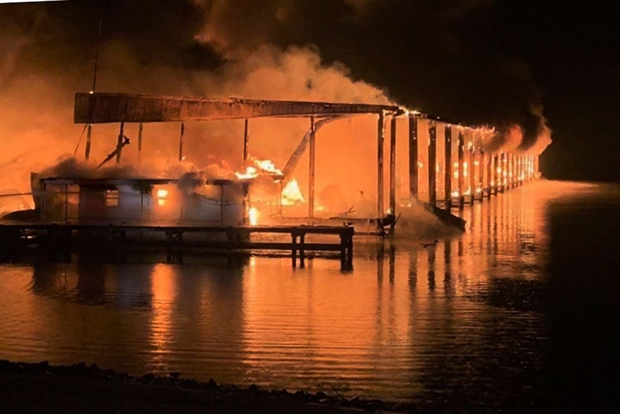 At least two dead, multiple missing in Alabama boat dock fire