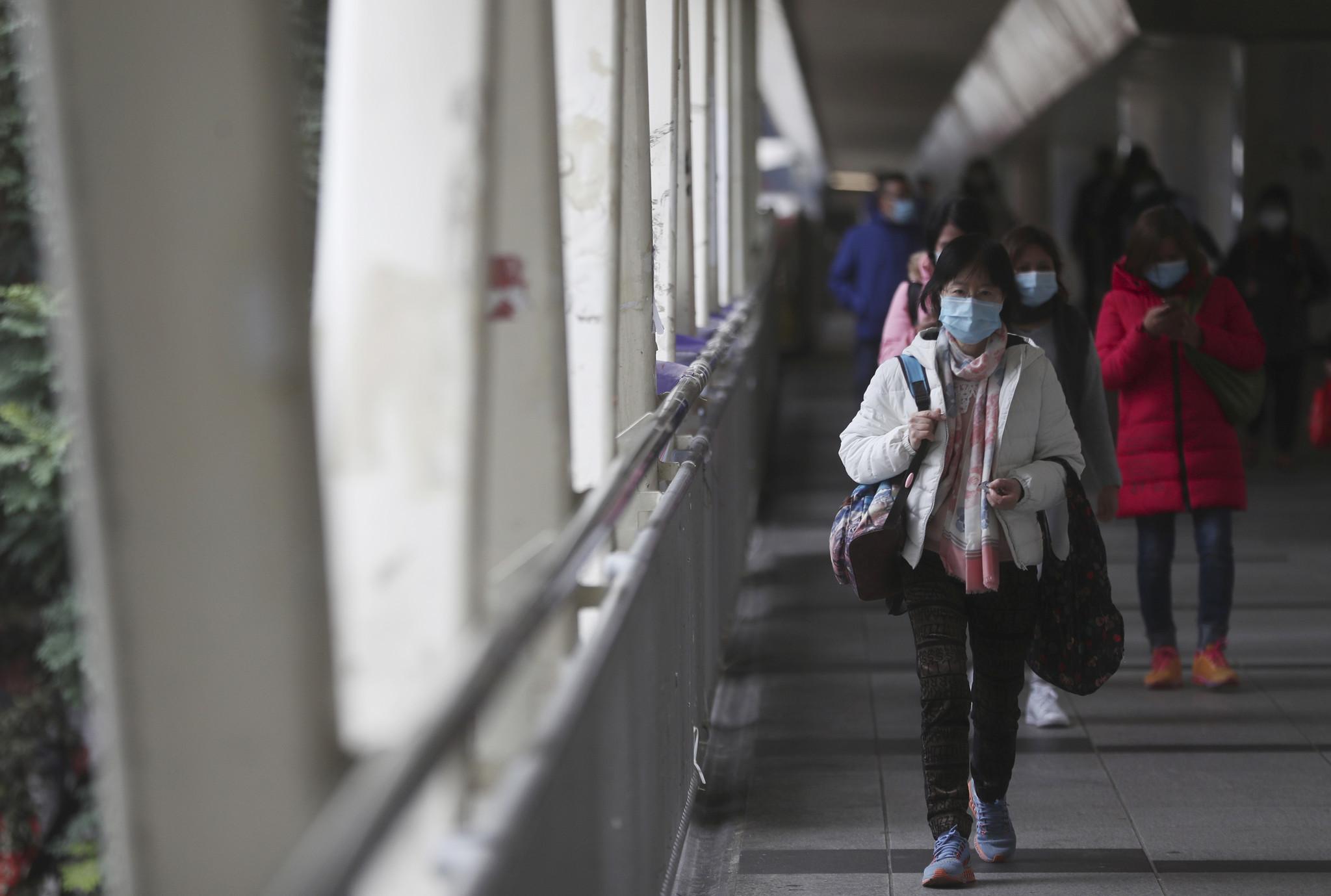 Hong Kong halts trains from mainland China as coronavirus death toll tops 100