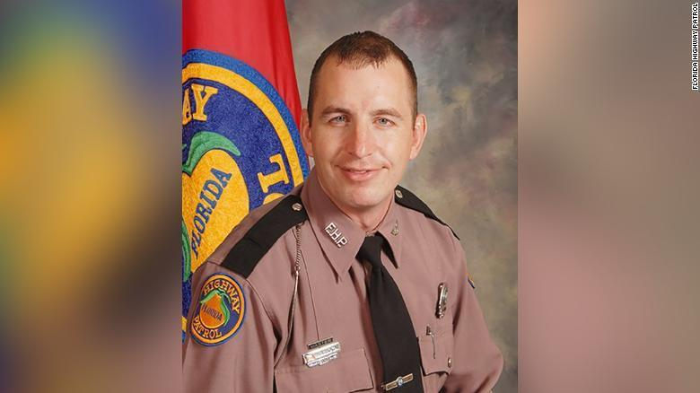 Florida trooper fatally shot by driver he was trying to help with a disabled car