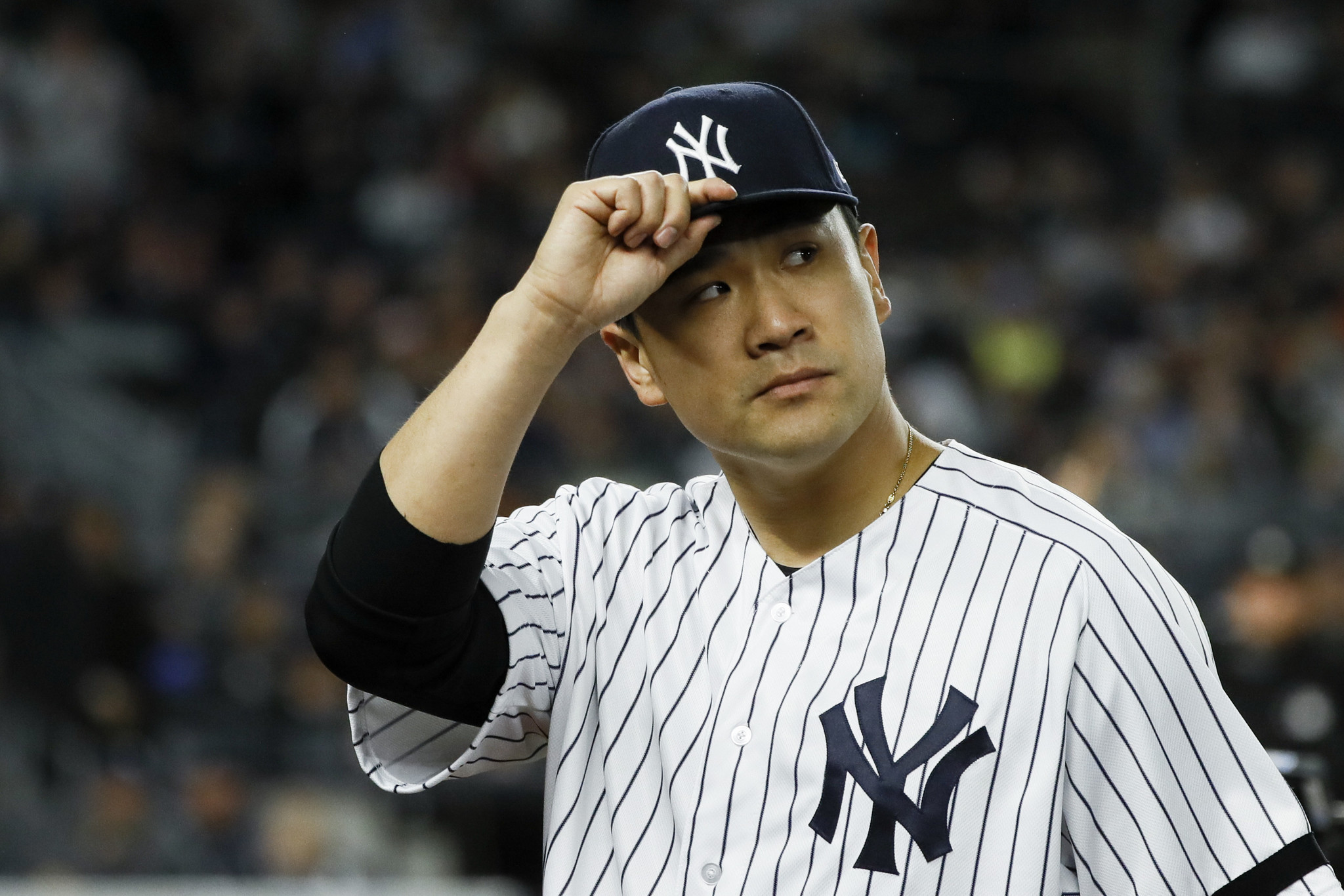 Yankees pitcher Masahiro Tanaka returns to Japan with his family over coronavirus concerns in the U.S.
