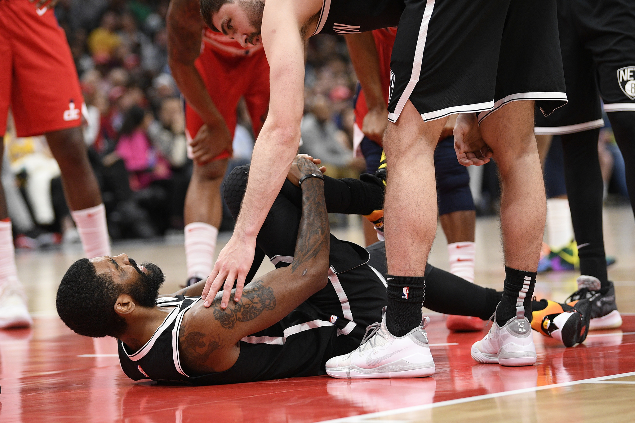 Kenny Atkinson says Nets will reevaluate Kyrie Irving's knee injury after the All-Star break
