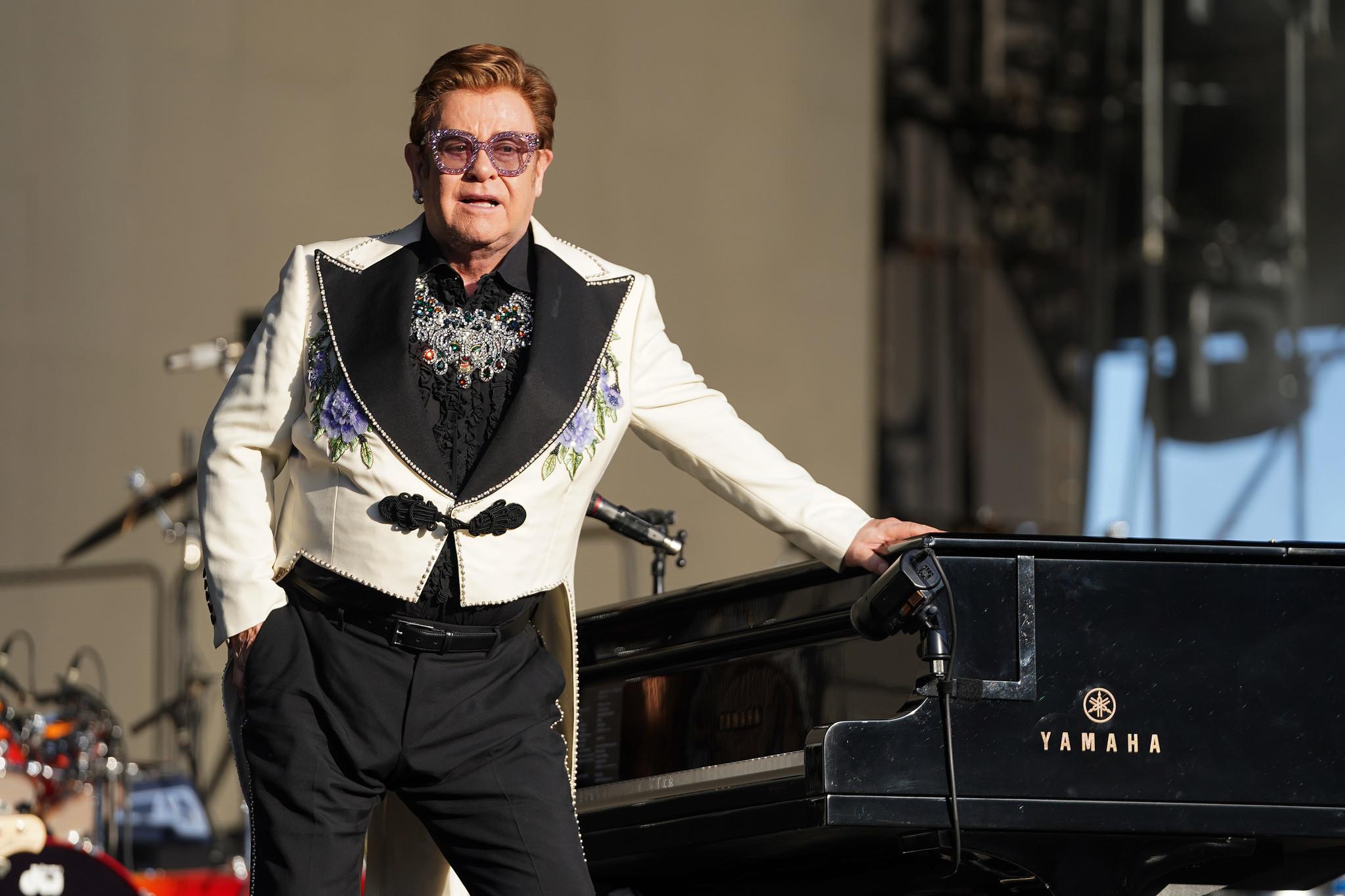Elton John announces he has walking pneumonia after ending New Zealand concert early