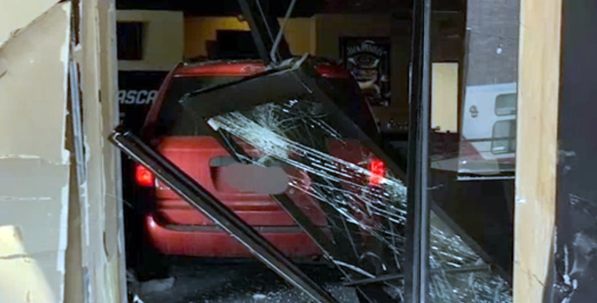 SEE IT: Colorado thieves crash stolen minivan into restaurant before robbery