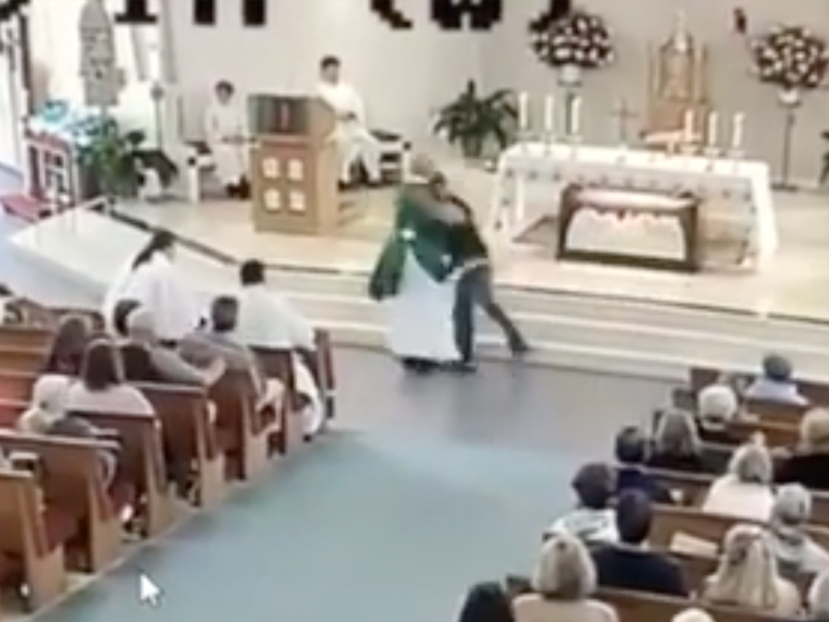 SEE IT: Bizarre video shows Florida man tackling church deacon during weekend mass