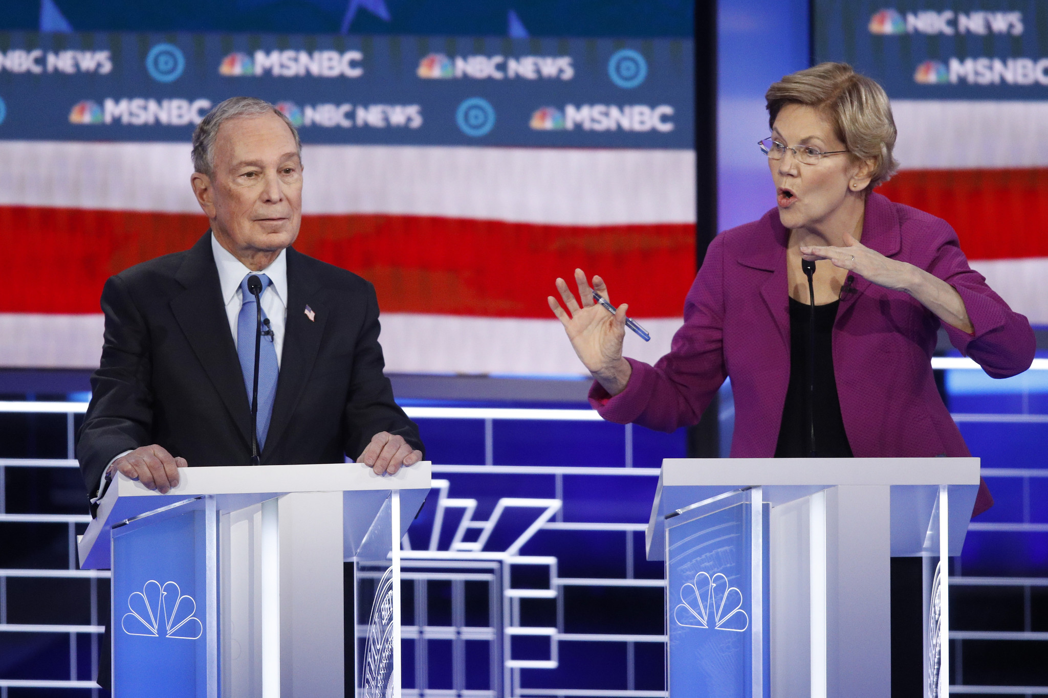 Bloomberg gets some space at Democratic debate as Mayor Pete slides in between him and Elizabeth Warren