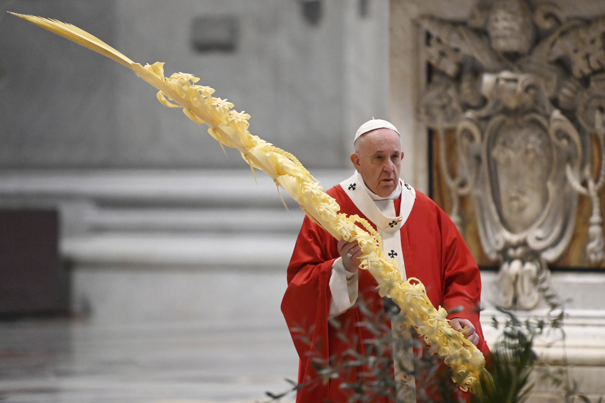 Pope holds Palm Sunday services at empty Vatican