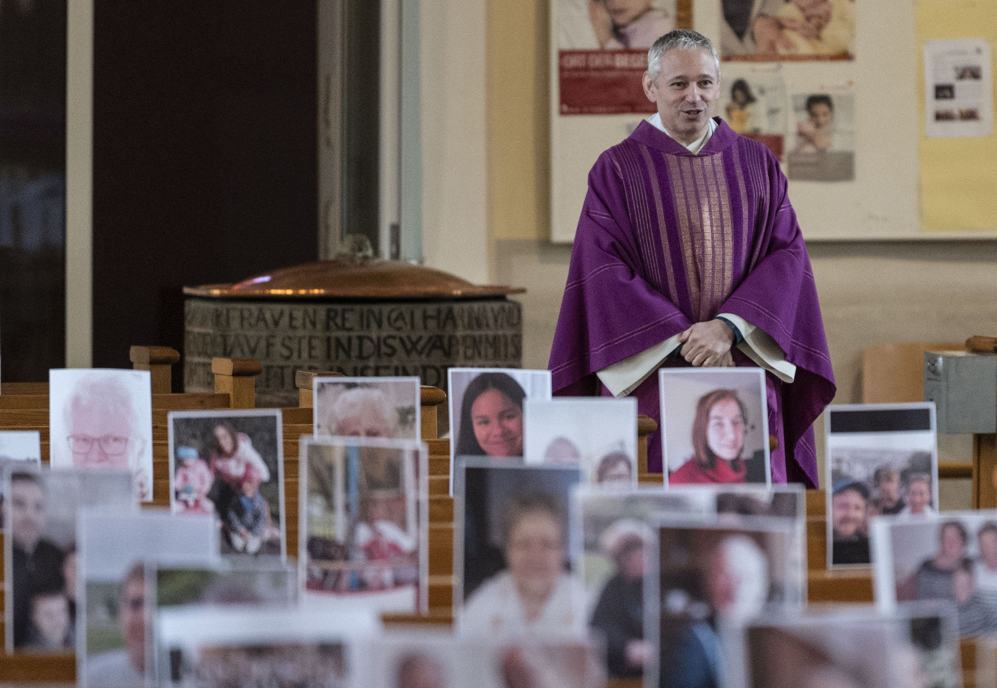 German priest prints out photos of congregants to 'attend' virtual mass